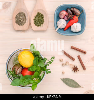 Fresh herbs and spices sage,rosemary,parsley,mint ,holy basil ,nutmeg,star anise ,cinnamon stick,oregano,thyme ,dill - Stock Image