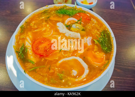 Pho Hai San, Vietnamese soup with seafood and rice noodles - Stock Image