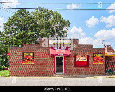 Front exterior entrance of a southern BBQ or barbecue restaurant in Montgomery Alabama, USA. - Stock Image
