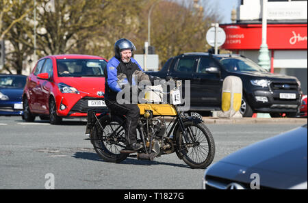 Brighton, UK. 24th March 2019. John Moore on his 1908 BAT weaves through the traffic as he nears the finish of the 80th Anniversary Pioneer Run for pre 2015 veteran motorcycles in Brighton. The run organised by the Sunbeam Motor Cycle Club begins on the Epsom Downs in Surrey and finishes on Madeira Drive on Brighton seafront Credit: Simon Dack/Alamy Live News - Stock Image