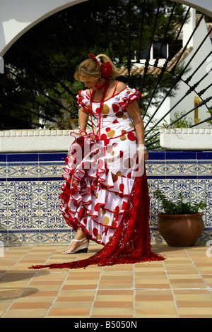 Beautiful blond middle aged Spanish woman in traditional costume, Andalucia, Spain - Stock Image