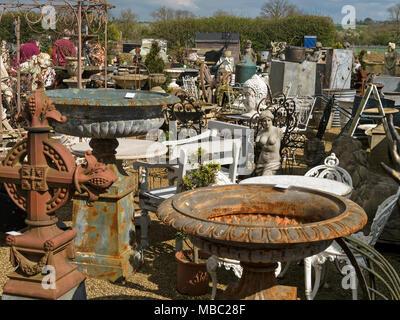 Old vintage & antique garden ornaments (statues, urns, planters, birdbaths) in reclamation yard, Garden Classics, Ashwell, Rutland, England, UK - Stock Image