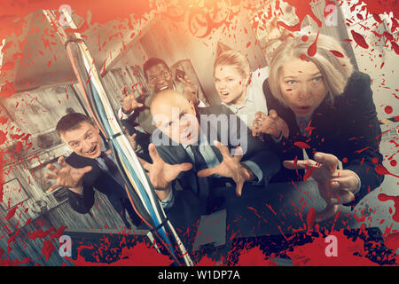 Group of adult men and women trying to get out of escape room stylized like thriller - Stock Image