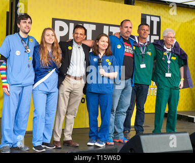 London, UK. 23rd Mar, 2019. Head of BMA Chaand Nagpaul with nurses, spaker at the People's Vote March and rally, 'Put it to the People.' Credit: Prixpics/Alamy Live News - Stock Image