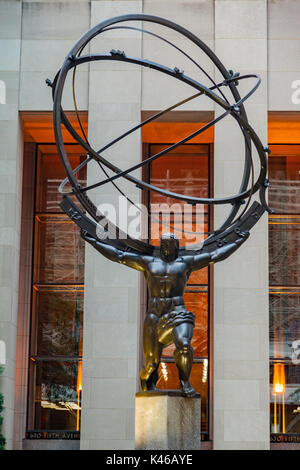 The bronze statue by Lee Lawrie (1937) Atlas holding the heavens at the facade of the Rockefeller Center in fifth avenue, Manhattan, New York - Stock Image