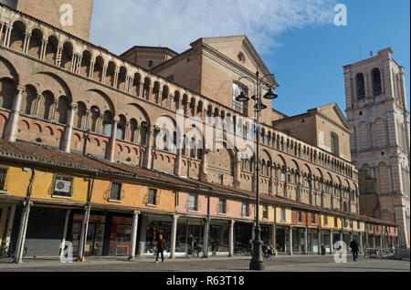 Loggia dei Mercanti arcades and San Giorgio cathedral side in Ferrara, Emilia Romagna,  Italy - Stock Image