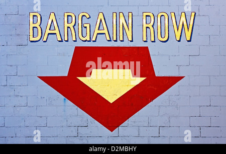 Bargain sign on side of wall - Stock Image