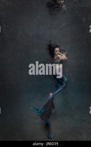 Mermaid in pool in Virginia Beach, VA - Stock Image