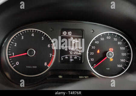 driving on empty fuel tank - fuel gauge showing 0 miles to empty - Stock Image