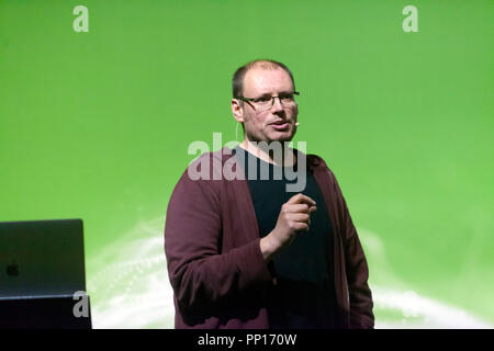 Biochemist,  Paul Race,  telling how his mission to identify new antibiotics on the Atlantic seabed could help us win the battle against antibacterial resistance, on the Earth Stage, at New Scientist Live - Stock Image