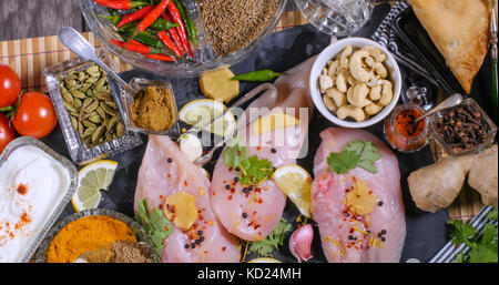 Top down close up view of ingredients and indian spices for chicken tikka masala - Stock Image