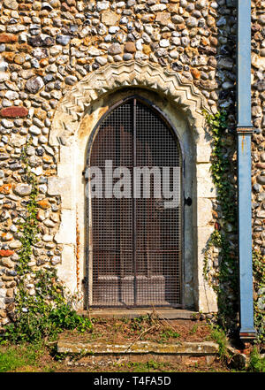 A view of a Norman arch in the south wall of the parish Church of St Margaret at Cantley, Norfolk, England, United Kingdom, Europe. - Stock Image