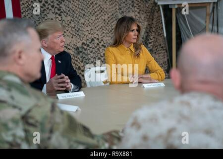 U.S. President Donald Trump and First Lady Melania Trump meet with military leaders and takes questions from the traveling media during a surprise visit to Al Asad Air Base December 26, 2018 in Al Anbar, Iraq. The president and the first lady spent about three hours on Boxing Day at Al Asad, located in western Iraq, their first trip to visit troops overseas since taking office. - Stock Image