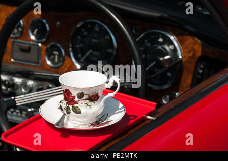 Elegant vintage tea pot with dashboard in background - Stock Image