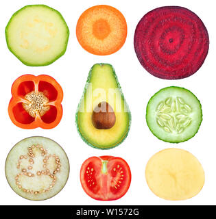 Isolated vegetable slices. Collection of fresh cut vegetables (zucchini, carrot, beetroot, bell pepper, avocado, cucumber, eggplant, tomato, potato) i - Stock Image