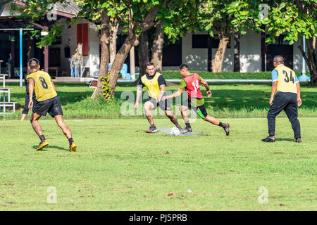 U.S. Army and Royal Thai Army Soldiers play soccer as part of sports day Aug. 24 during Hanuman Guardian 2018 at the Royal Thai Army's Cavalry Center in the Saraburi province. Hanuman Guardian, Aug. 20 – 30, demonstrates the U.S. and Kingdom of Thailand's commitment to its longstanding alliance while also strengthening the capabilities of both forces. - Stock Image