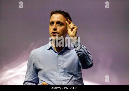 Cosmologist Roberto Trotta talking about Einstein and how his work has impacted on our everyday life, on the Cosmos Stage, at New Scientist Live - Stock Image
