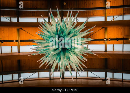 green crystal structure hanging from the top of the celing of crystal bridge museum - Stock Image