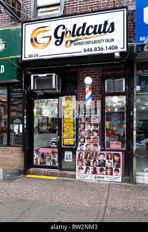 The exterior of Goldcuts Barber Shop & Beauty Salon on Roosevelt Ave. in Jackson Heights, Queens, New York City - Stock Image