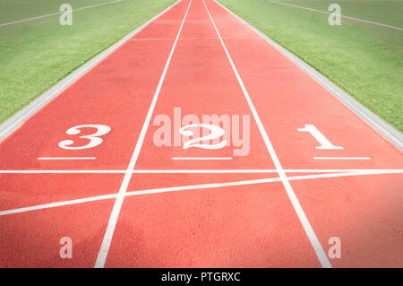 Numbers three two and one on a tartan running track - Stock Image