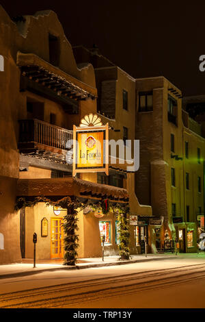 La Fonda Hotel under snow, Santa Fe, New Mexico USA - Stock Image