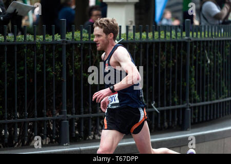John Gilbert (Kent AC),  competing in the 2019 London Marathon. John finished 2nd in his category, in a time of 02:19:03. - Stock Image