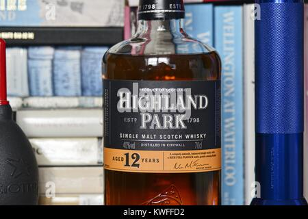 Highland Park Single Malt Scotch Whisky - Bottle on a Bookshelf - Stock Image