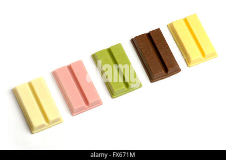 Variety of KitKat flavours from Japan. (sweet potato, red bean, matcha (green tea), raspberry, sake) - Stock Image