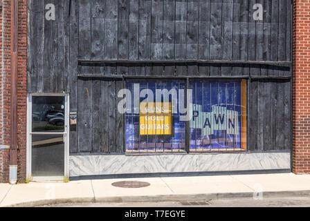 JOHNSON CITY, TN, USA-4/27/19: Albert's Loan & Pawn Shop: guns, gold, guitars: weathered plank store front. - Stock Image
