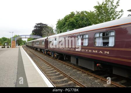 The Royal Scotsman rail carriages waiting at Tain railway station in the County of Ross, in the Highlands of Scotland, UK. - Stock Image
