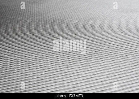 Repeating texture on flat surface, white. - Stock Image