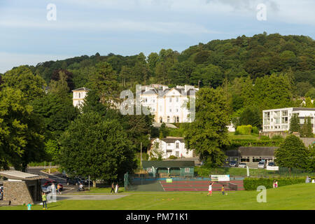 The Glebe, tennis courts and Belsfield hotel at Bowness-on-Windermere The Belsfield hotel was built as a house in 1845 and became a hotel in 1892. - Stock Image