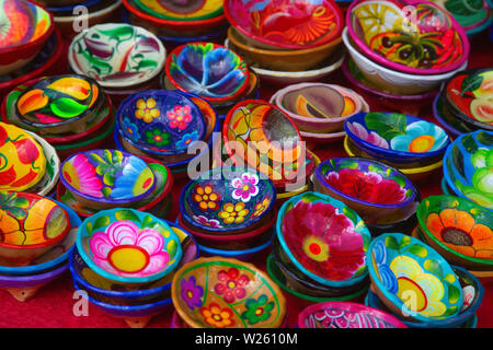 Colorful traditional mexican ceramics on the street market - Stock Image