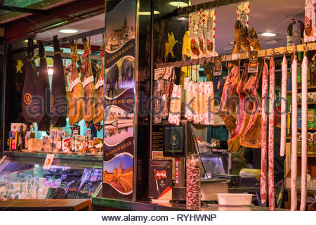 Display of hams and salami in Triana Market - Stock Image