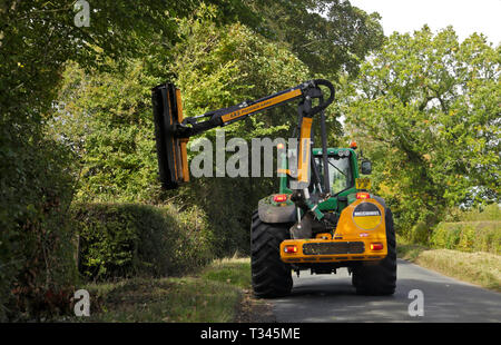 Hedge Trimmer Tractor, Gloucestershire, England - Stock Image