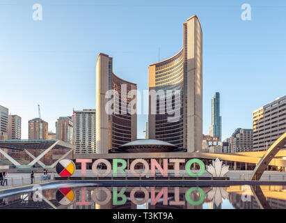 Toronto sign in Nathan Phillips Square - Stock Image