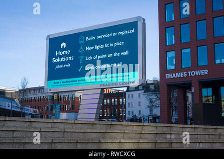 'Reading Lights', the new giant  illuminated LED billboard outside Reading Station, Berkshire, here advertising 'Home Solutions' at John Lewis departm - Stock Image