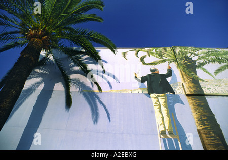 France Nice wall painting palm tree blue sky - Stock Image