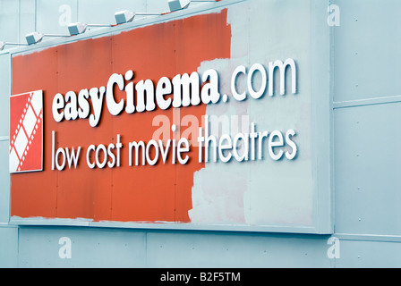 The demise of the Easy Cinema easyCinema com low cost movie theaters sign being painted over in Central Milton Keynes - Stock Image
