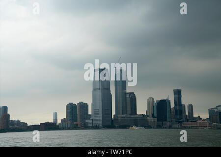 Jersey City, N.J. and the Hudson River under a cloudy sky. June 17, 2019 - Stock Image