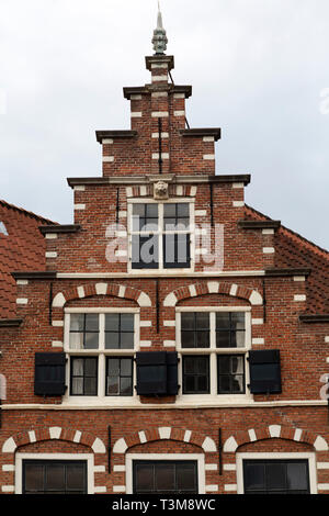A traditional gabled house facade in Haarlem, the Netherlands. The building is constructed of bricks. - Stock Image