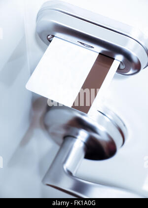 Hotel room key card in an electronic door lock - Stock Image