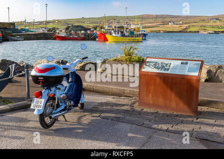 Portmagee Fishing Village, County Kerry, Ireland with Honda Little Cub moped - Stock Image