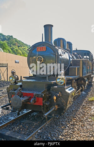 Steam locomotive at Tournon station awaiting to depart on the Train De L'Ardeche along the River Doux gorge to Lamastre - Stock Image