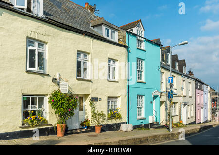 Brightly painted terraced houses in the seaside town of Padstow, Cornwall, England - Stock Image