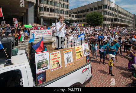 Boston, Massachusetts, USA. 30th June, 2018.  U.S. Senator Elizabeth Warren (Democrat Massachusetts) raises her fist as she spoke to thousands from the back of a truck at Boston City Hall during the Rally against Family Separation in Boston, MA. Demonstrations against U.S. President Donald Trump's immigration policy of detaining central American and Mexican immigrants and the separation of immigrant families.  Large rallies against President Trump's policy of separating migrant families took place in more than 750 U.S. cities on June 30th of 2018. Chuck Nacke / Alamy Live News - Stock Image