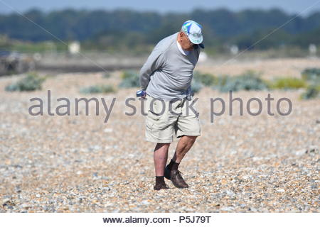 Littlehampton, UK. Wednesday 27th June 2018. A man takes a morning stroll on the beach on another very warm and sunny morning in Littlehampton, on the South Coast. Credit: Geoff Smith / Alamy Live News. - Stock Image
