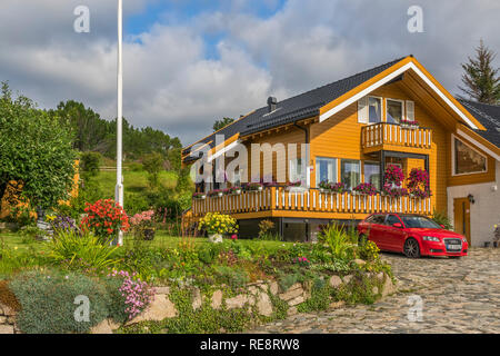 House and Garden In The Lofoten Islands, Norway - Stock Image