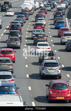 Traffic building up on the M25 near Heathrow airport during a sunny bank holiday in the UK. - Stock Image