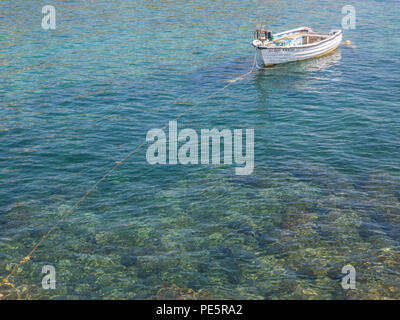 A small Cypriot fishing boat in turquoise water - Stock Image